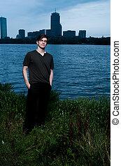 Young man at river