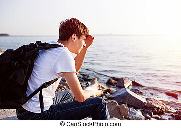 Young Man at Seaside - Young Man with Backpack at the...