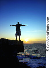 Young man at sunset.
