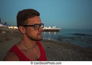 man at the evening sea