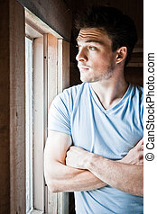 Young man at the window