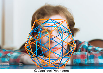 Young Man Behind The Volumetric Model Of Geometric Solid