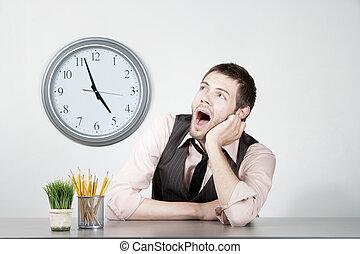 Young man bored at work - Handosme young man bored at the...