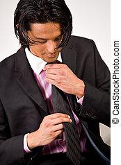 Young man bounding his necktie
