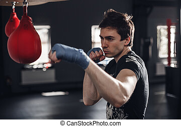 Young man boxing workout in a fitness club