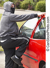 Young Man Breaking Into Car