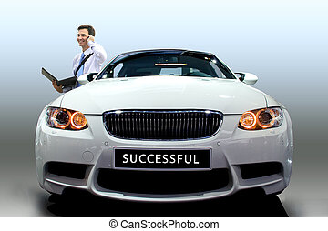 Young businessman by modern white car