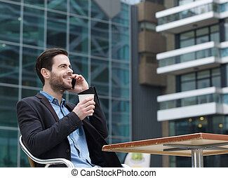 Young man calling by cellphone