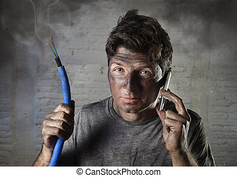 young man calling for help after accident with dirty burnt face in funny sad expression