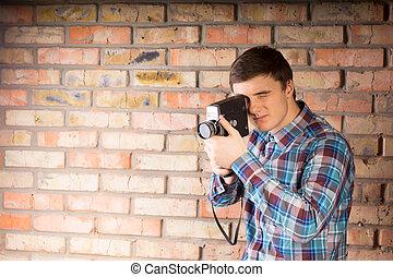 Young Man Capturing Something Using Camera
