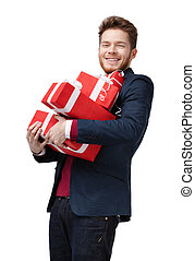 Young man carries a lot of presents