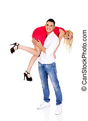 Young man carrying his girlfriend on the shoulder