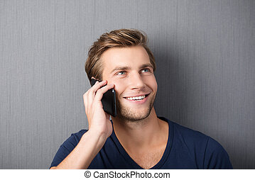 Young man chatting on a smartphone