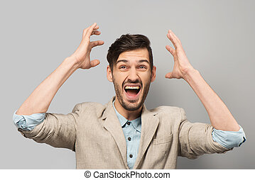 Young man cheerfully smiling