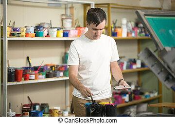 Young man combining CMYK