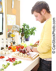 Young man cooking healthly food