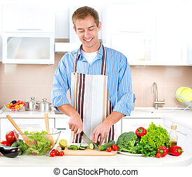 Young Man Cooking. Healthy Food