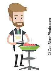 Young man cooking meat on the barbecue grill.