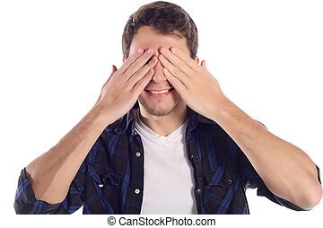 Young man covering his eyes with hands.