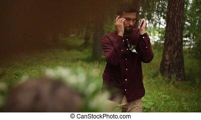 Young man dances nature