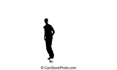 Young man dancing breakdance on one hand, white, silhouette, slow motion