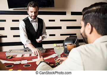 Young man dealing cards in a casino