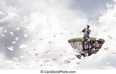 Young man do not want to see anything and paper planes fly aroun