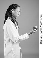 Young man doctor with dreadlocks in black and white
