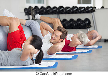 Young man doing a fitness course