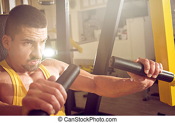 Young man doing chest workout
