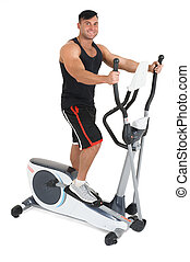 young man doing exercises on elliptical cross trainer