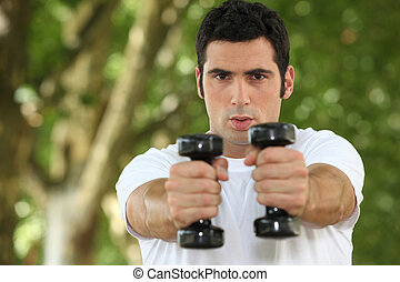 young man doing fitness in a park