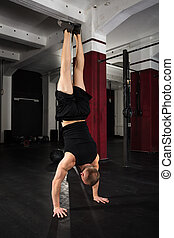 Young Man Doing Handstand Exercise