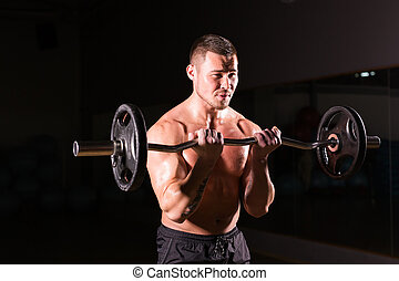 young man doing heavy weight exercise for biceps.