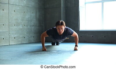 Young man doing push-ups.