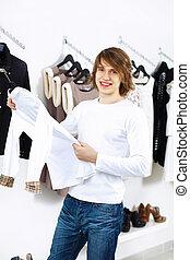 Young man doing shopping