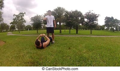 Young man doing sit-ups, exercising