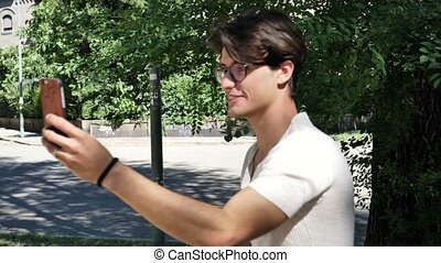 Young man doing videochat outdoor