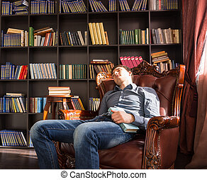 Young man dozing off in a public library