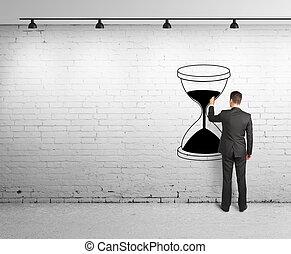 man drawing hourglass