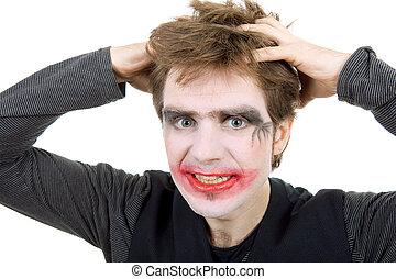 joker - young man dressed as joker, isolated on white