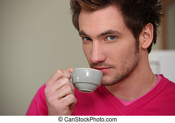Young man drinking an expresso