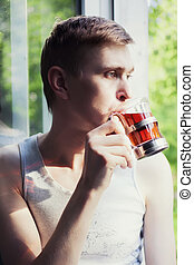 Young man drinking tea