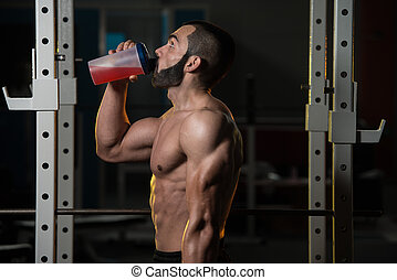 Young Man Drinking Water From Bottle