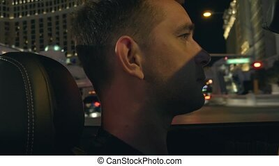 Man in a car in Las Vegas. - Young man driving a car...