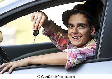 young man driving in the car