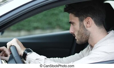 Young Man Driving the Car, Using GPS