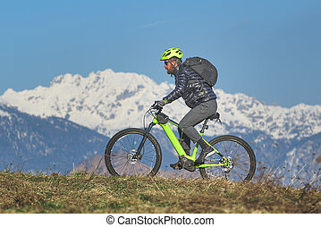 Young man during mountain bike excursion in the hill
