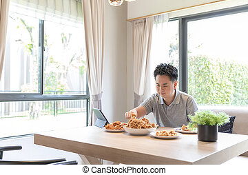 young man eating at home