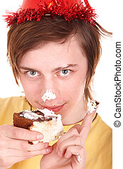 Young man eating chocolate cake.